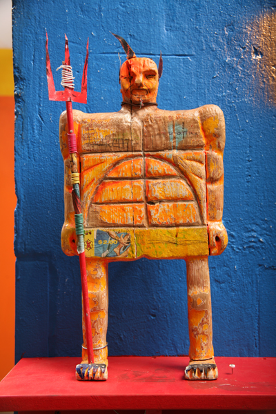Date Farmers  &nbsp -  <strong>Yellow Devil</strong> (2008<strong style = 'color:#635a27'></strong>)<bR /> Carved Wood and Mixed Media Sculpture,   17 x 10 inches