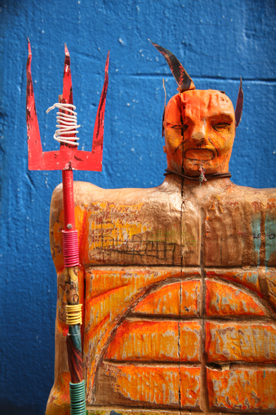 Date Farmers  &nbsp -  <strong>Yellow Devil (detail)</strong> (2008<strong style = 'color:#635a27'></strong>)<bR /> Carved Wood and Mixed Media Sculpture,   17 x 10 inches