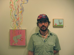 "Ben  Woodward -  <strong>Ben Woodward</strong> (<strong style = 'color:#635a27'></strong>)<bR /> Ben Woodward with his works ""Vapors"" and ""Heart Out"""