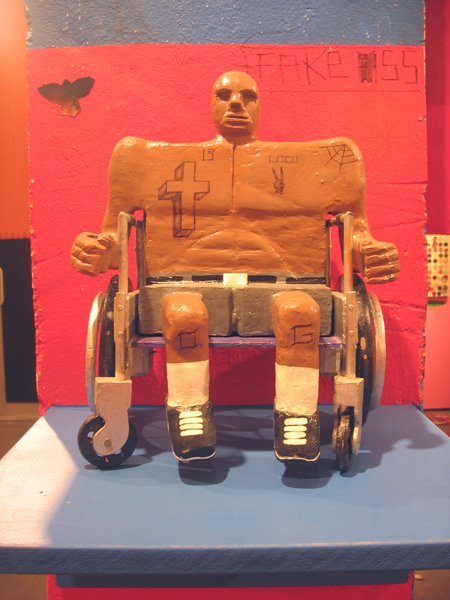 Date Farmers  &nbsp -  <strong>Disability</strong> (2008<strong style = 'color:#635a27'></strong>)<bR /> Carved Wood and Mixed Media Sculpture,   14 x 10 x 8 inches