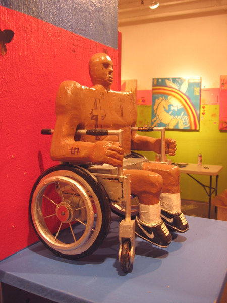 Date Farmers  &nbsp -  <strong>Disability (three-quarter view)</strong> (2008<strong style = 'color:#635a27'></strong>)<bR /> Carved Wood and Mixed Media Sculpture,   14 x 10 x 8 inches