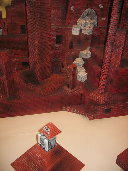 "Andrew  Schoultz -  <strong>Untitled Installation</strong> (2006<strong style = 'color:#635a27'></strong>)<bR /> <font face=""Arial"">Mixed media with hand sculpted buildings and figures,   Dimensions variable</font>"