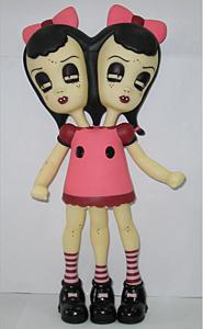 "Camille Rose  Garcia -  <strong>Katie and Sadie</strong> (2004<strong style = 'color:#635a27'></strong>)<bR /> <span class=""mainpage"">Vinyl toy created by Necessaries Toy Foundation</span>,   14 inches high<span class=""mainpage"" />"