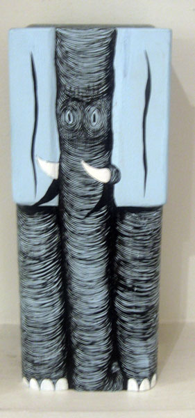 Andrew  Schoultz -  <strong>Small Elephant</strong> (2006<strong style = 'color:#635a27'></strong>)<bR /> Hand-Carved and Painted,   Acrylic on Wood Sculpture,   10 x 4 x 4 inches
