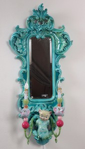 Adam  Wallacavage -  <strong>Mother Puncher (mirror sconce)</strong> (2009<strong style = 'color:#635a27'></strong>)<bR /> mirror, epoxy resin-coated plaster and lamp parts,   38 x 18 x 9 3/4 inches   (96.5 x 45.7 x 24.8 cm)