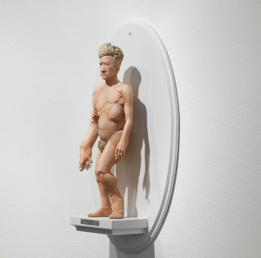 Mike Leavitt -  <strong>David Lynch (side)</strong> (2016<strong style = 'color:#635a27'></strong>)<bR /> hand-carved western red cedar, fimo, sculpey polymer clay and acrylic paint, 18 inches (45.7 cm)