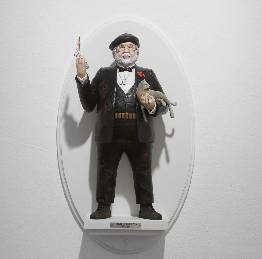 Mike Leavitt -  <strong>Francis Ford Coppola</strong> (2016<strong style = 'color:#635a27'></strong>)<bR /> hand-carved western red cedar, fimo, sculpey polymer clay and acrylic paint, 18 inches (45.7 cm)