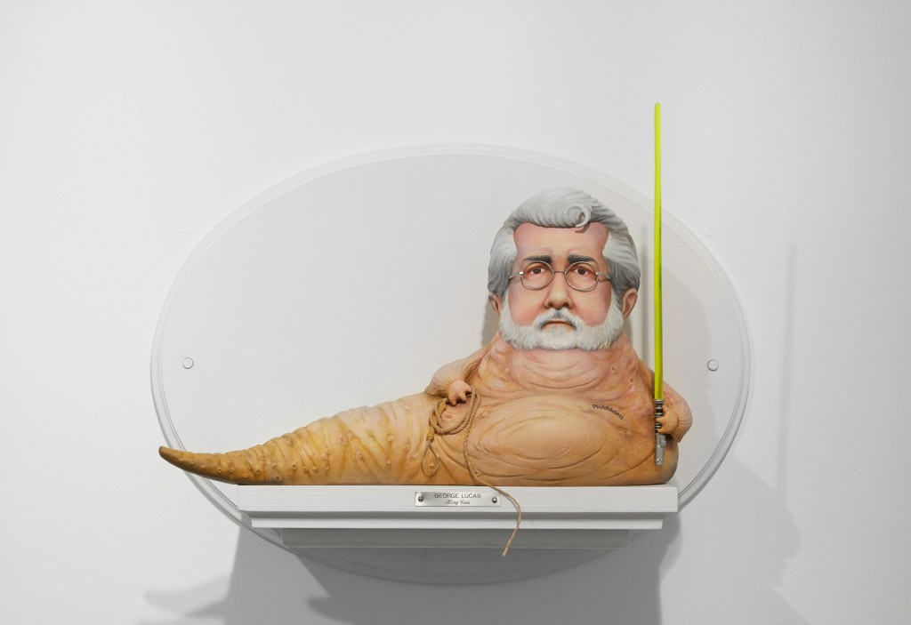 Mike Leavitt -  <strong>George Lucas</strong> (2016<strong style = 'color:#635a27'></strong>)<bR /> hand-carved western red cedar, yellow cedar and acrylic paint, 18 inches (45.7 cm)
