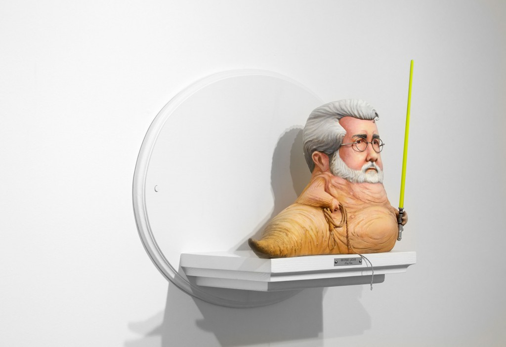 Mike Leavitt -  <strong>George Lucas (side)</strong> (2016<strong style = 'color:#635a27'></strong>)<bR /> hand-carved western red cedar, yellow cedar and acrylic paint, 18 inches (45.7 cm)