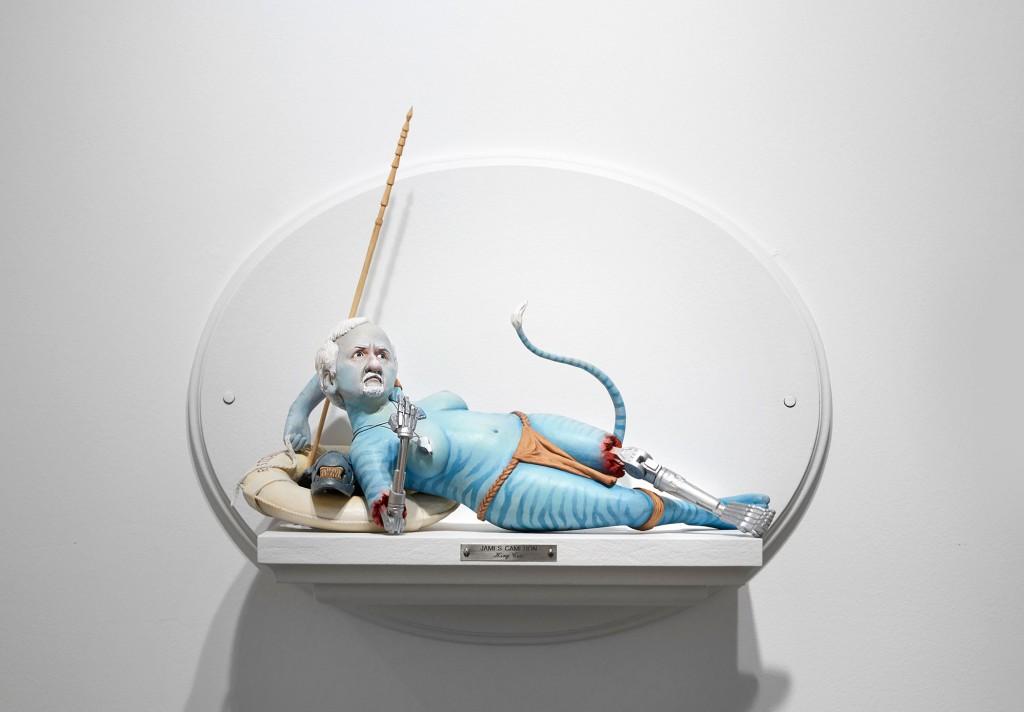 Mike Leavitt -  <strong>James Cameron</strong> (2016<strong style = 'color:#635a27'></strong>)<bR /> hand-carved western red cedar, douglass fir, white pine, fimo, sculpey polymer clay and acrylic paint, 18 inches (45.7 cm)