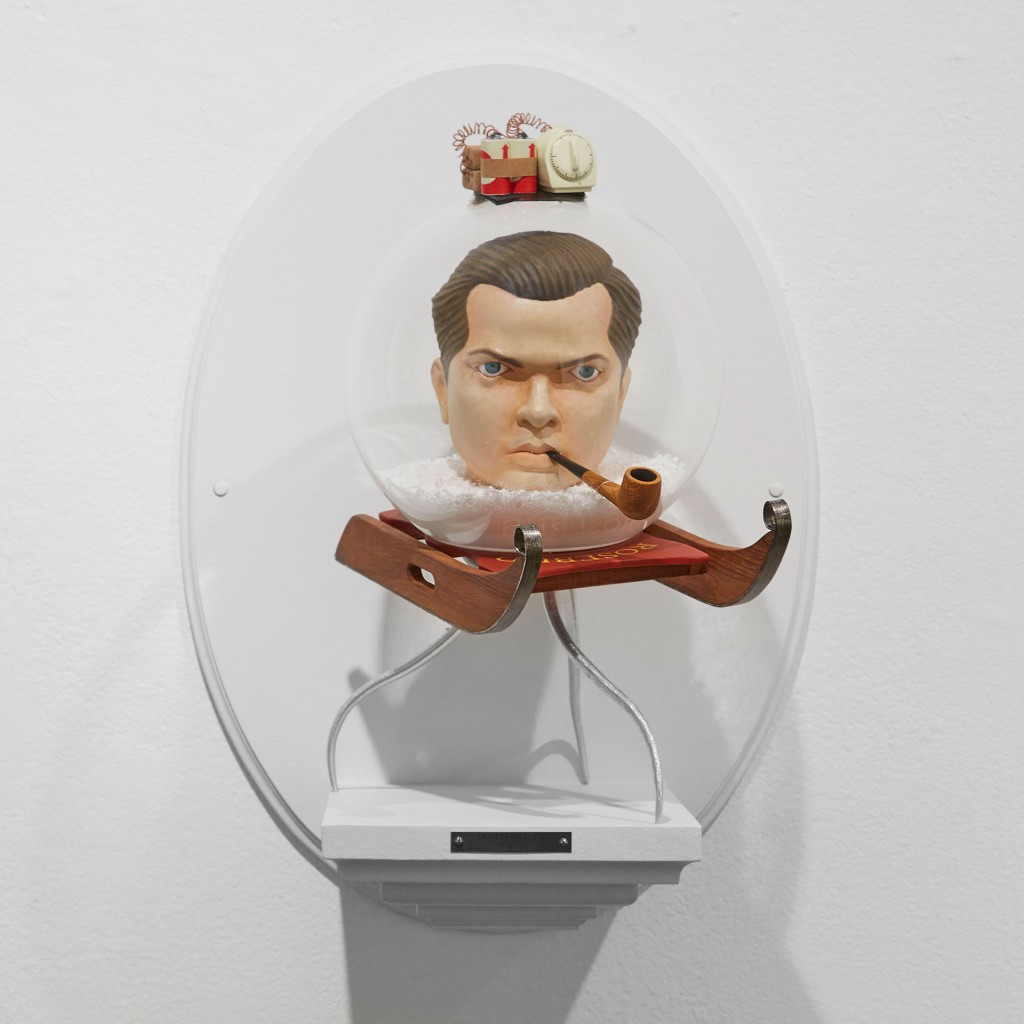 Mike Leavitt -  <strong>Orson Welles</strong> (2016<strong style = 'color:#635a27'></strong>)<bR /> hand-carved western red cedar, douglass fir, white pine, aluminum rails, acrylic globe and acrylic paint, 18 inches (45.7 cm)