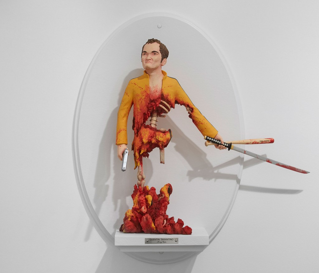 Mike Leavitt -  <strong>Quentin Tarantino</strong> (2016<strong style = 'color:#635a27'></strong>)<bR /> hand-carved western red cedar, white pine, fimo, sculpey polymer clay and acrylic paint, 18 inches (45.7 cm)