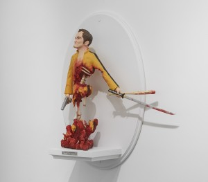 Mike Leavitt -  <strong>Quentin Tarantino (side)</strong> (2016<strong style = 'color:#635a27'></strong>)<bR /> hand-carved western red cedar, white pine, fimo, sculpey polymer clay and acrylic paint, 18 inches (45.7 cm)