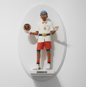 Mike Leavitt -  <strong>Spike Lee</strong> (2016<strong style = 'color:#635a27'></strong>)<bR /> hand-carved western red cedar, fimo, sculpey polymer clay and acrylic paint, 18 inches (45.7 cm)