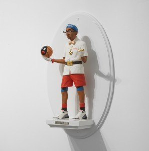 Mike Leavitt -  <strong>Spike Lee (side)</strong> (2016<strong style = 'color:#635a27'></strong>)<bR /> hand-carved western red cedar, fimo, sculpey polymer clay and acrylic paint, 18 inches (45.7 cm)
