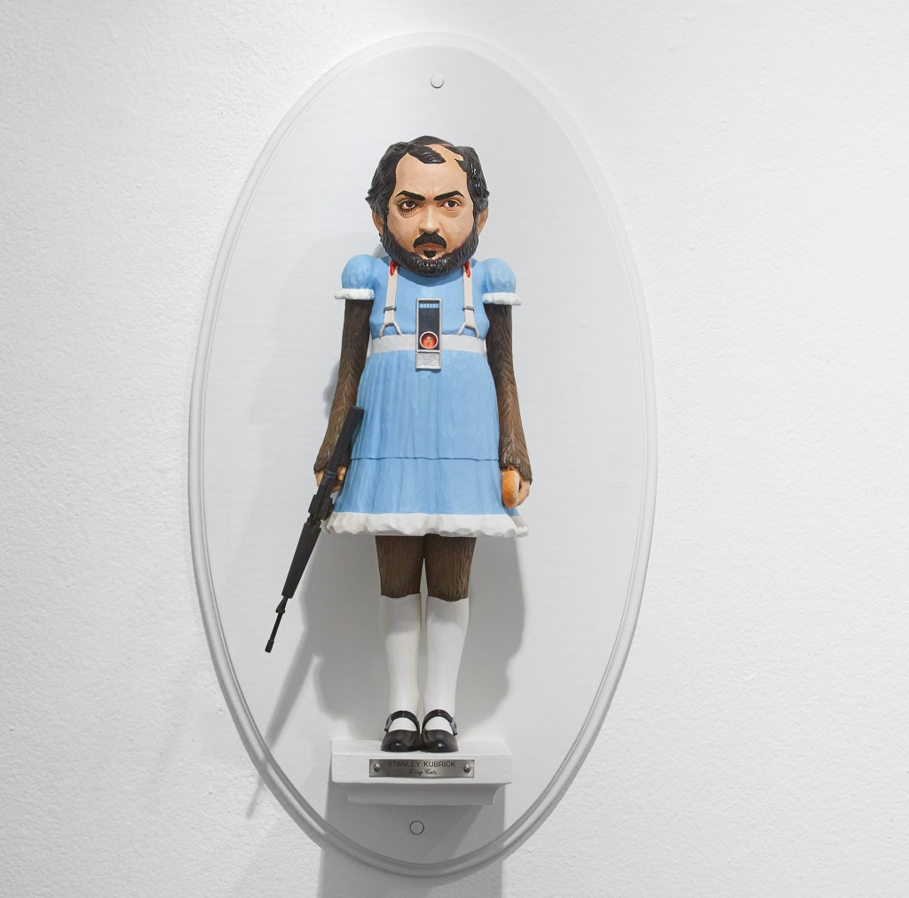 Mike Leavitt -  <strong>Stanley Kubrick</strong> (2016<strong style = 'color:#635a27'></strong>)<bR /> hand-carved western red cedar, fimo, sculpey polymer clay and acrylic paint, 18 inches (45.7 cm)