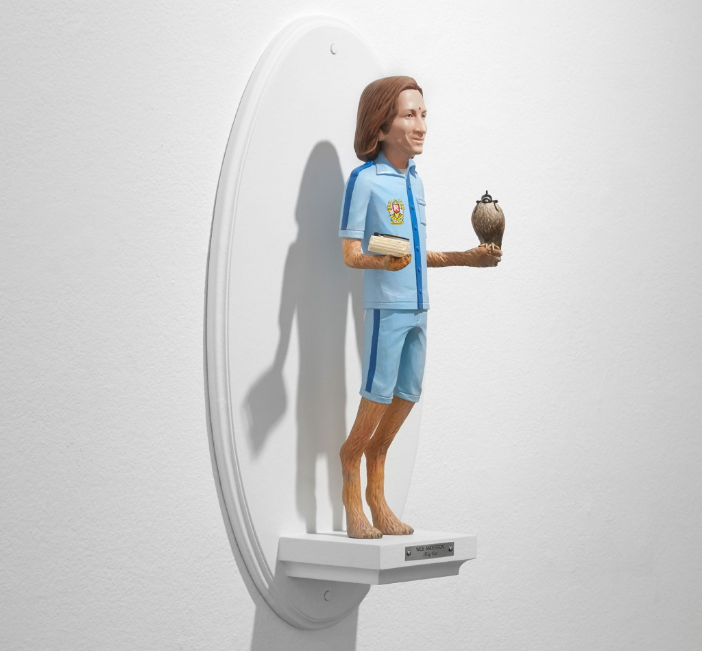 Mike Leavitt -  <strong>Wes Anderson (side)</strong> (2016<strong style = 'color:#635a27'></strong>)<bR /> hand-carved western red cedar, fimo, sculpey polymer clay and acrylic paint, 18 inches (45.7 cm)