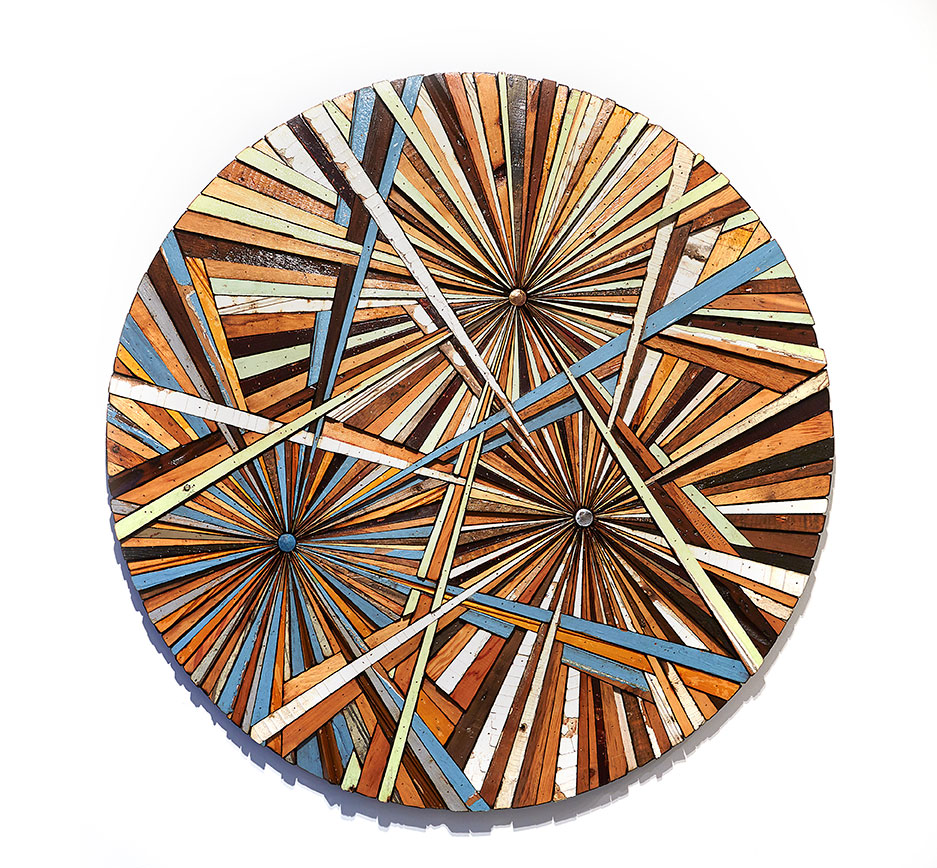 Roddy Wildeman -  <strong>Composite Memory Tri-Burst (NJ Shore Towns)</strong> (2014<strong style = 'color:#635a27'></strong>)<bR /> reclaimed materials on plywood, 46 inches diameter