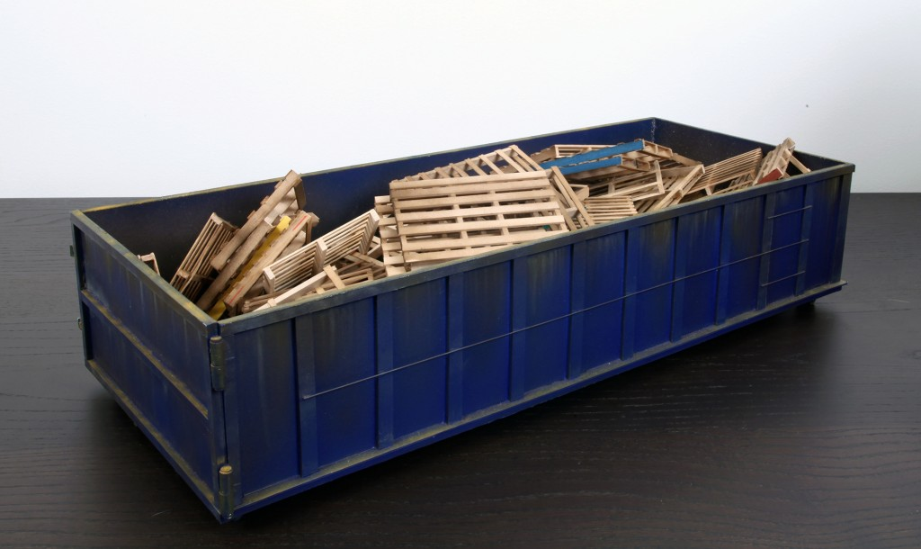 Drew Leshko -  <strong>Blue 30 Yard Dumpster with 55 Pallets (side)</strong> (2016<strong style = 'color:#635a27'></strong>)<bR /> paper, enamel, acrylic, dry pigments, wire, wood,