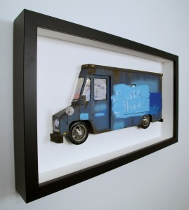 Drew Leshko -  <strong>Blue Buff LLV (side)</strong> (2016<strong style = 'color:#635a27'></strong>)<bR /> paper, enamel, dry pigments, acrylic, plastic, clay, wire, inkjet print, toy hubcaps. Framed in shadowbox without glass,
