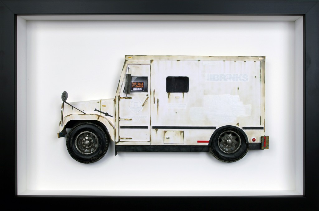 Drew Leshko -  <strong>Brinks Truck</strong> (2016<strong style = 'color:#635a27'></strong>)<bR /> paper, enamel, dry pigments, acrylic, plastic, wire, inkjet print, toy wheels. Framed in shadowbox without glass,