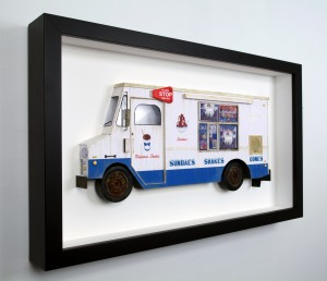 Drew Leshko -  <strong>Mr. Softee (side)</strong> (2016<strong style = 'color:#635a27'></strong>)<bR /> paper, enamel, dry pigments, acrylic, plastic, wire, clay, inkjet prints, toy hubcaps. Framed in shadowbox without glass,