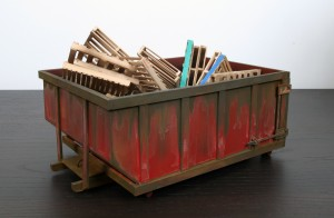 Drew Leshko -  <strong>Red 10 Yard Dumpster with 30 Pallets (side)</strong> (2016<strong style = 'color:#635a27'></strong>)<bR /> paper, enamel, acrylic, dry pigments, wire, wood, 5.5 x 10.75 x 7.75 inches, (13.97 x 27.3 x 19.68 cm)