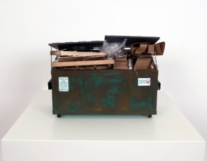 Drew Leshko -  <strong>Small Green Dumpster with Trash</strong> (2016<strong style = 'color:#635a27'></strong>)<bR /> paper, enamel, acrylic, dry pigments, wire, wood, plastic,