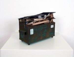 Drew Leshko -  <strong>Small Green Dumpster with Trash (side)</strong> (2016<strong style = 'color:#635a27'></strong>)<bR /> paper, enamel, acrylic, dry pigments, wire, wood, plastic,