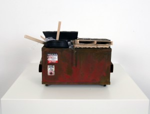 Drew Leshko -  <strong>Small Red Dumpster with Trash</strong> (2016<strong style = 'color:#635a27'></strong>)<bR /> paper, enamel, acrylic, dry pigments, wire, wood, plastic,
