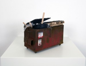 Drew Leshko -  <strong>Small Red Dumpster with Trash (side)</strong> (2016<strong style = 'color:#635a27'></strong>)<bR /> paper, enamel, acrylic, dry pigments, wire, wood, plastic,