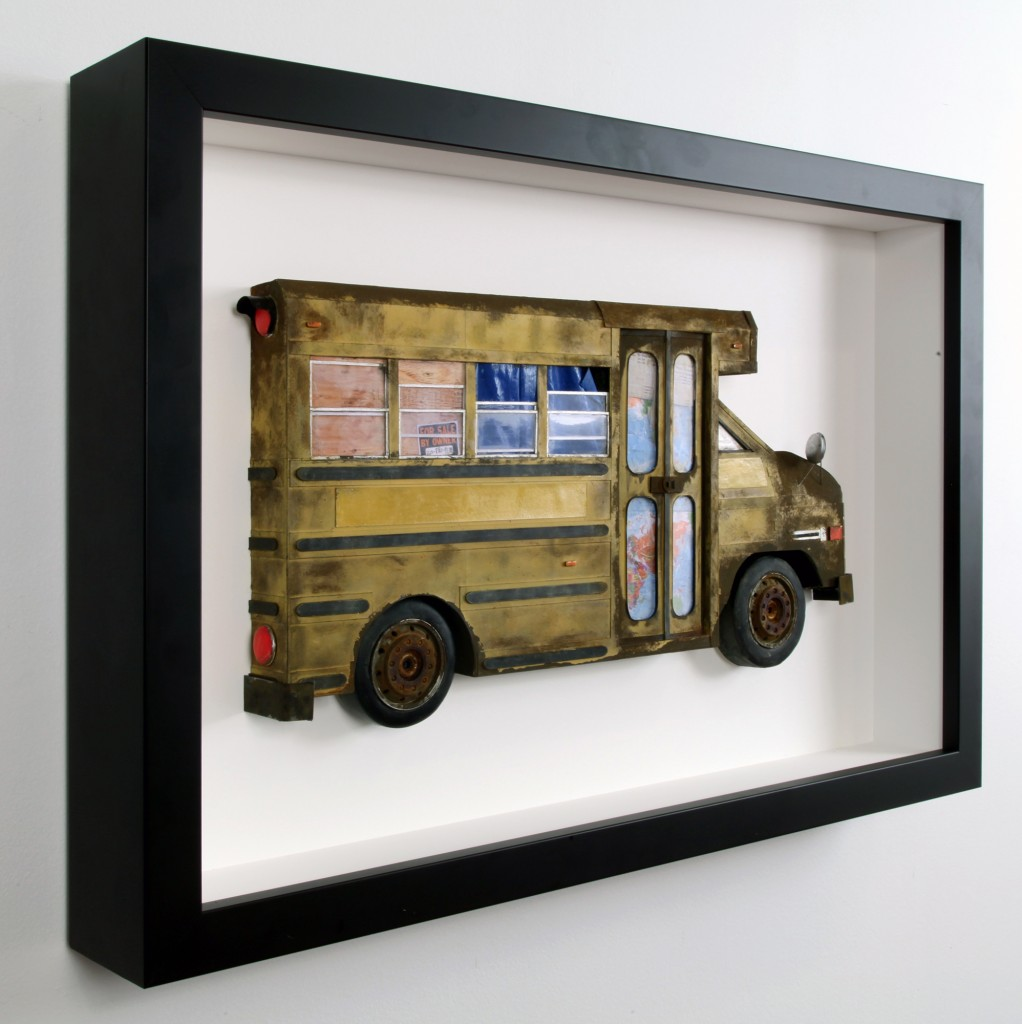 Drew Leshko -  <strong>Small School Bus (side)</strong> (2016<strong style = 'color:#635a27'></strong>)<bR /> paper, enamel, dry pigments, acrylic, plastic, wire, clay, inkjet prints, toy hubcaps. Framed in shadowbox without glass,