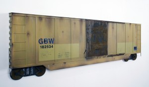 Drew Leshko -  <strong>Yellow Boxcar 40' (side)</strong> (2016<strong style = 'color:#635a27'></strong>)<bR /> paper, enamel, acrylic, dry pigments, wire, ink on wood panel,