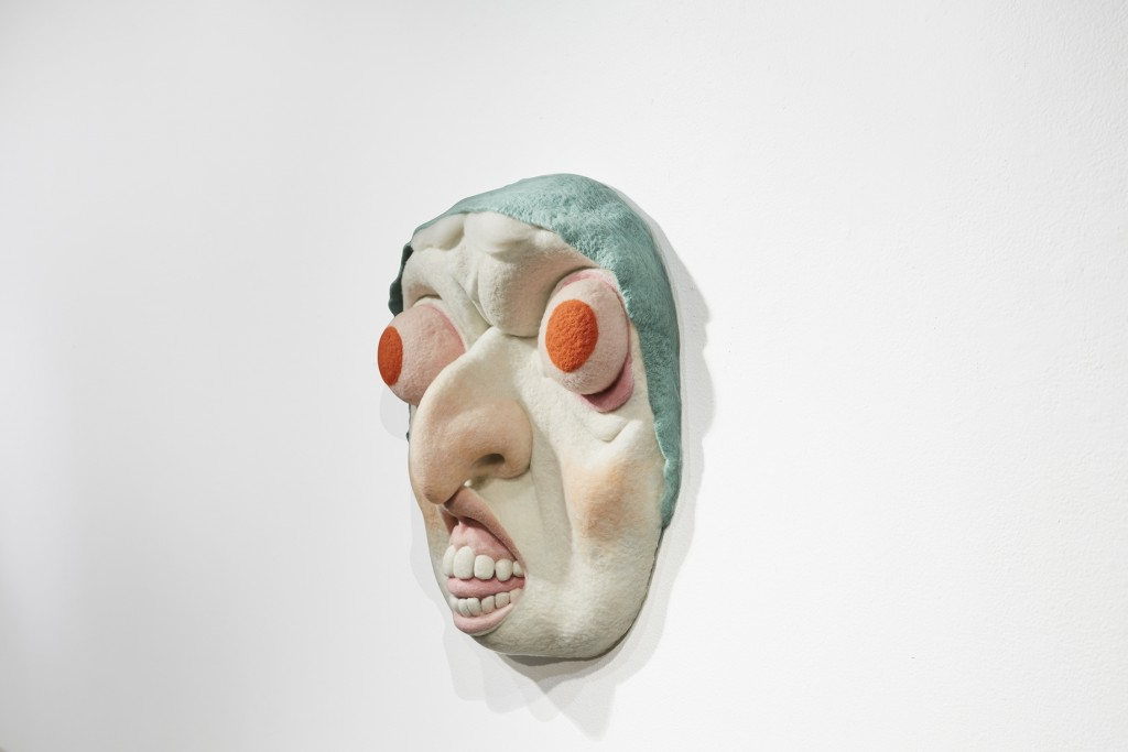 Paolo Del Toro -  <strong>Baba Yaga (side)</strong> (2016<strong style = 'color:#635a27'></strong>)<bR /> sculpted Styrofoam core covered with hand-dyed needle felted merino wool, 26 x 26 x 8 inches, (66 x 66 x 20.3 cm)