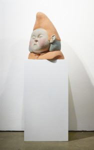 Paolo Del Toro -  <strong>Sleeping Witch (side)</strong> (2016<strong style = 'color:#635a27'></strong>)<bR /> sculpted Styrofoam core covered with hand-dyed needle felted merino wool, 23 x 19 x 10 inches, (58.4 x 48.3 x 25.4 cm)