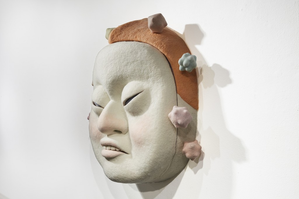 Paolo Del Toro -  <strong>The Visitor (side)</strong> (2016<strong style = 'color:#635a27'></strong>)<bR /> sculpted Styrofoamcore covered with hand-dyed needle felted merino wool, 26 x 26 x 13 inches, (66 x 66 x 33 cm)