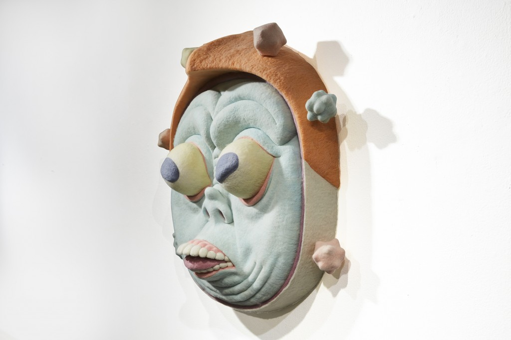 Paolo Del Toro -  <strong>The Visitor (side)</strong> (2016<strong style = 'color:#635a27'></strong>)<bR /> sculpted Styrofoam core covered with hand-dyed needle felted merino wool, 26 x 26 x 13 inches, (66 x 66 x 33 cm)