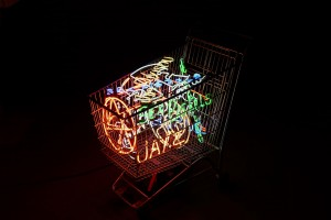 Alê Jordão -  <strong>Supermarket Trolley</strong> (2016<strong style = 'color:#635a27'></strong>)<bR /> iron, neon light and power transformer 220V,  40 x 41.3 x 21.5 inches