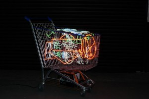 Alê Jordão -  <strong>Supermarket Trolley</strong> (2016<strong style = 'color:#635a27'></strong>)<bR /> iron, neon light and power transformer 220V,  40 x 41.3 x 21.5 inches, $9,000