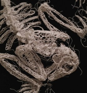 Caitlin McCormack -  <strong>Kindertide (detail)</strong> (2015<strong style = 'color:#635a27'></strong>)<bR /> crocheted cotton string, glue, steel pins and velvet, 36 x 24 x 3.5 inches
