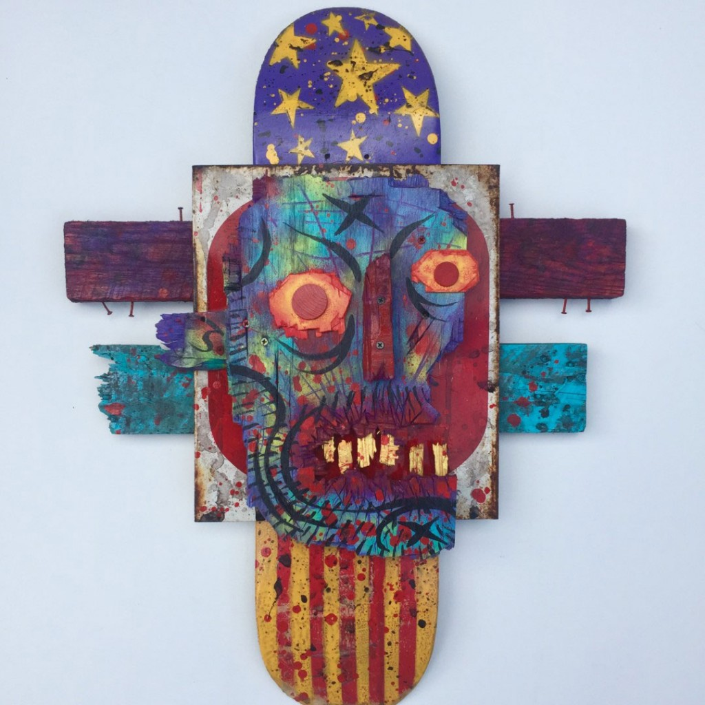Charles Bennett -  <strong>America Eats its Own</strong> (2017<strong style = 'color:#635a27'></strong>)<bR /> acrylic and spray paint on reclaimed wood and skateboard, 24 x 32 x 3 inches, $1,000