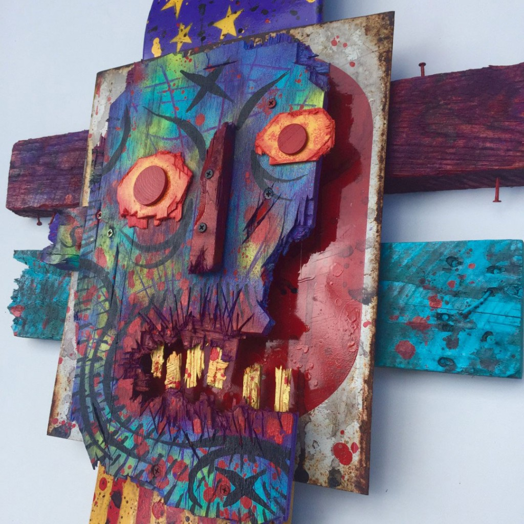 Charles Bennett -  <strong>America Eats its Own (detail)</strong> (2017<strong style = 'color:#635a27'></strong>)<bR /> acrylic and spray paint on reclaimed wood and skateboard, 24 x 32 x 3 inches, $1,000