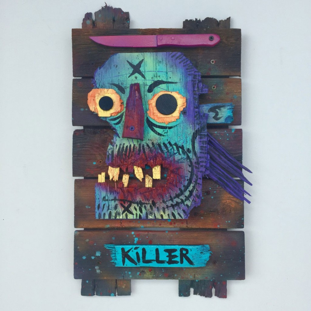Charles Bennett -  <strong>Killer Mullett</strong> (2017<strong style = 'color:#635a27'></strong>)<bR /> acrylic and spray paint on reclaimed wood, 21.2 x 21.6 x 1 inches, $700
