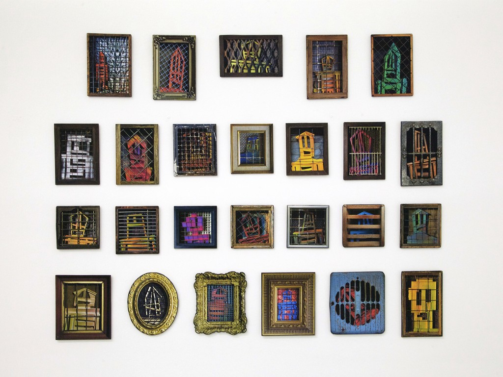 Stikman -  <strong>25 Trapped Men</strong> (2017<strong style = 'color:#635a27'></strong>)<bR /> wood and printed paper,	 25 individual works approximately 6 x 4 inches each,  (installation: 22 x 30 inches)