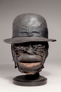 Ronald Gonzalez (Third place winner) -  <strong>Fat Lip</strong> (2017<strong style = 'color:#635a27'></strong>)<bR /> re-purposed boxing gloves, hat, cloth, leather, wax, wire carbon, metal filings over welded steel, 12 x 10 x 10 inches, $1,600