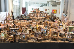 Jeff Gillette -  <strong>Disneyland Slumpark</strong> (2017<strong style = 'color:#635a27'></strong>)<bR /> Inspired by visits to India's Urban Slums. Materials from the Mojave Desert, collected refuse and re-purposed paintings. All pieces sold separately