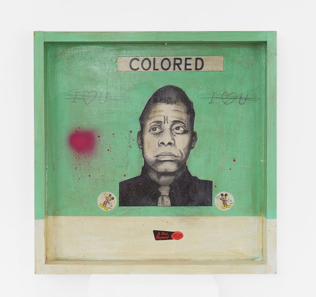 Carlos Ramirez -  <strong>Woolwoorths (James Baldwin)</strong> (2017<strong style = 'color:#635a27'></strong>)<bR /> acrylic, spray paint and mixed media on wood, 24 x 24 x 4 inches