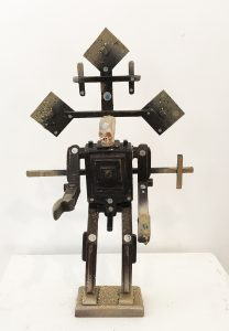 Carlos Ramirez -  <strong>The Ghost of Pakal</strong> (2017<strong style = 'color:#635a27'></strong>)<bR /> balsa wood, clay, spray paint, acrylic and found objects, $1,500