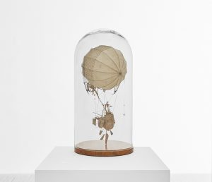 Daniel Agdag -  <strong>The Northwesterly</strong> (2017<strong style = 'color:#635a27'></strong>)<bR /> cardboard and trace paper mounted on timber base with hand-blown glass dome, 23 x 12 x 12 inches