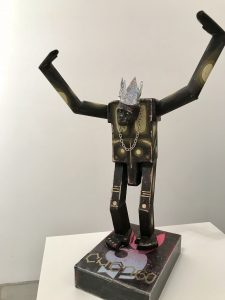 Carlos Ramirez -  <strong>Super Chimp</strong> (2017<strong style = 'color:#635a27'></strong>)<bR /> Balsa wood, clay, spray paint, acrylic and found objects, 16 x 12 x 7 inches, $1,500